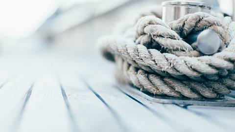 A yacht's rope wound round a cleat