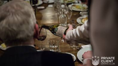 A photo from Private Client Dining of a businessman having wine poured