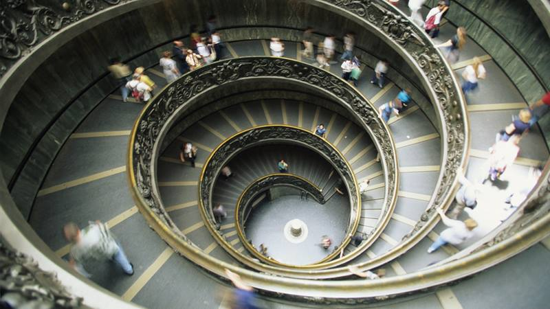 People going up a spiral staircase